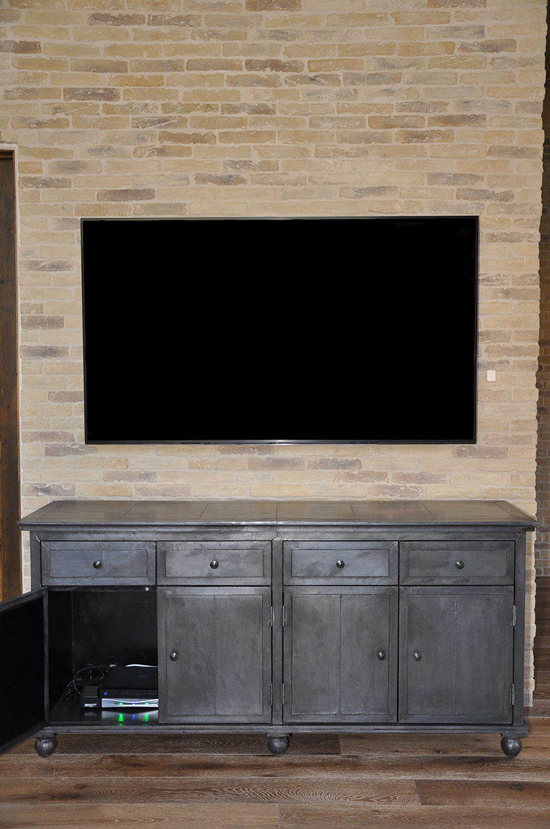 Living room TV, mounted on the wall, showing components