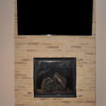 Master Bedroom TV, mounted on the wall, with hidden components behind it