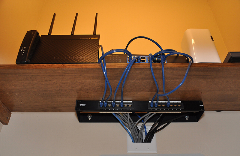 Close-up view of Cable Modem, Router, and Network Switch